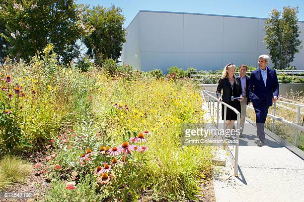 US Secretary of State John Kerry viewing the Facebook rooftop garden with Facebook employees Brenda Tierney and Brian Rice Menlo Park California June...