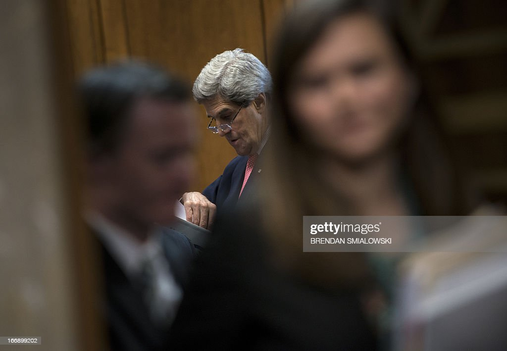 US Secretary of State John Kerry waits for a hearing of the Senate Foreign Relations Committee on Capitol Hill on April 18, 2013 in Washington, DC. Kerry appeared before the committee to testify about the administration's FY2014 international affairs budget. AFP PHOTO/Brendan SMIALOWSKI