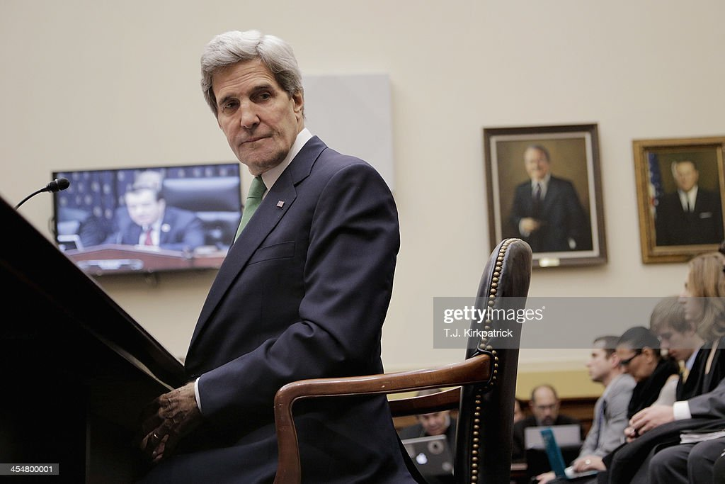 Secretary of State <a gi-track='captionPersonalityLinkClicked' href=/galleries/search?phrase=John+Kerry&family=editorial&specificpeople=154885 ng-click='$event.stopPropagation()'>John Kerry</a> waits to testify before the House Foreign Affairs Committee on December 10, 2013 in Washington, DC. During his testimony Secretary Kerry asked on behalf of the Obama Administration that congress hold off on sanctioning Iran to give diplomacy a chance to work its course.
