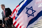 US Secretary of State John Kerry walks past American and Israeli flags at Ben Gurion International Airport in Tel Aviv on January 6 2014 Kerry is...