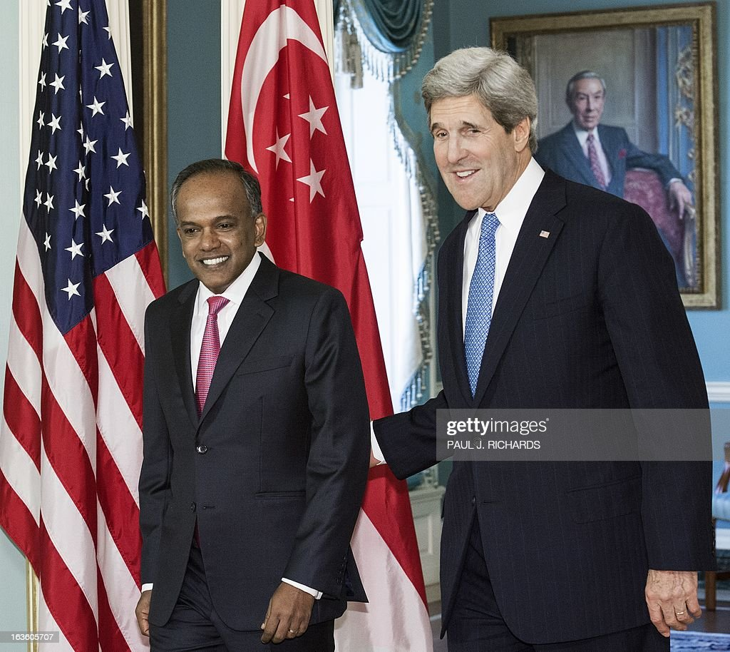 US Secretary of State John Kerry walks with Foreign Minister of Singapore K. Shanmugam(L), into the Treaty Room of the US State Department to deliver remarks to the media before their private bilateral meeting March 13, 2013, in Washington, DC. AFP Photo/Paul J. Richards