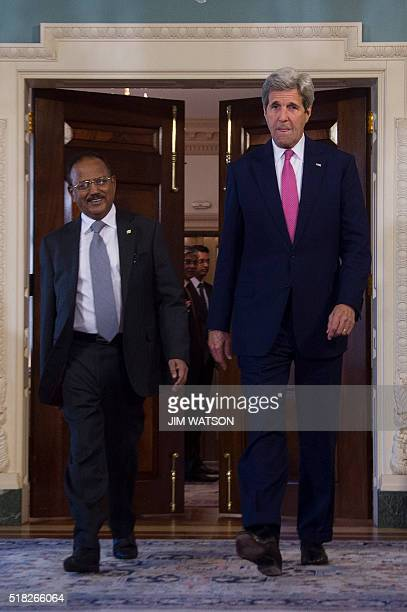 US Secretary of State John Kerry walks with Indian National Security Advisor Ajit Doval at the State Department in Washington DC March 30 2016 / AFP...