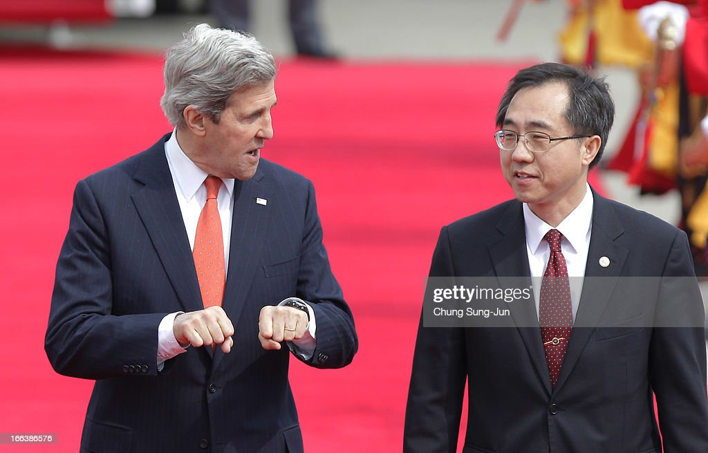 U.S. Secretary Of State <a gi-track='captionPersonalityLinkClicked' href=/galleries/search?phrase=John+Kerry&family=editorial&specificpeople=154885 ng-click='$event.stopPropagation()'>John Kerry</a> (L) walks with South Korean officer Moon Seung-Hyun from foreign ministry after arriving at Seoul military airport on April 12, 2013 in Seoul, South Korea. Kerry is on a tour of Asia, visiting South Korea and Japan and will discuss issues surrounding North Korea.
