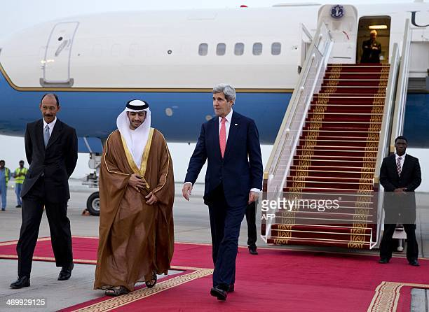 US Secretary of State John Kerry walks with US ambassador to the United Arab Emirates Michael Corbin and Shihab alFaheem Assistant Undersecretary for...