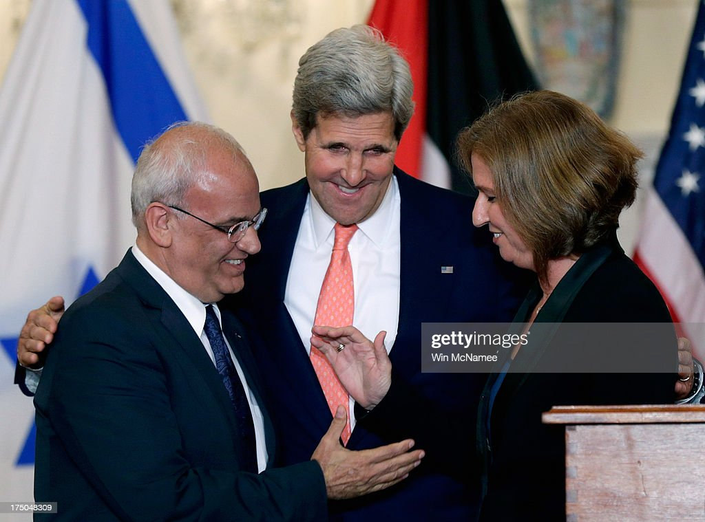 U.S. Secretary of State <a gi-track='captionPersonalityLinkClicked' href=/galleries/search?phrase=John+Kerry&family=editorial&specificpeople=154885 ng-click='$event.stopPropagation()'>John Kerry</a> (C) watches as Israeli Justice Minister <a gi-track='captionPersonalityLinkClicked' href=/galleries/search?phrase=Tzipi+Livni&family=editorial&specificpeople=537394 ng-click='$event.stopPropagation()'>Tzipi Livni</a> and Palestinian chief negotiator <a gi-track='captionPersonalityLinkClicked' href=/galleries/search?phrase=Saeb+Erekat&family=editorial&specificpeople=233560 ng-click='$event.stopPropagation()'>Saeb Erekat</a> (L) shake hands during a presser on the Middle East Peace Process Talks at the Department of State on July 30, 2013 in Washington, DC. Israeli Justice Minister <a gi-track='captionPersonalityLinkClicked' href=/galleries/search?phrase=Tzipi+Livni&family=editorial&specificpeople=537394 ng-click='$event.stopPropagation()'>Tzipi Livni</a> and Palestinian chief negotiator <a gi-track='captionPersonalityLinkClicked' href=/galleries/search?phrase=Saeb+Erekat&family=editorial&specificpeople=233560 ng-click='$event.stopPropagation()'>Saeb Erekat</a> joined Kerry in some of the first direct talks in three years between Israel and Palestine.