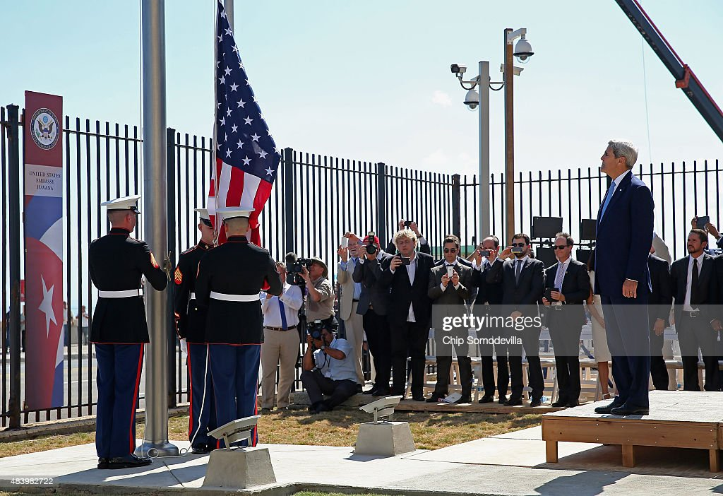 Secretary of State <a gi-track='captionPersonalityLinkClicked' href=/galleries/search?phrase=John+Kerry&family=editorial&specificpeople=154885 ng-click='$event.stopPropagation()'>John Kerry</a> (R) watches as Marines raise the American flag at the U.S. Embassy August 14, 2015 in Havana, Cuba. Kerry will visited the reopened embassy, the first time an American secretary of state has visited Cuba since 1945, a symbolic act after the the two former Cold War enemies reestablished diplomatic relations in July.