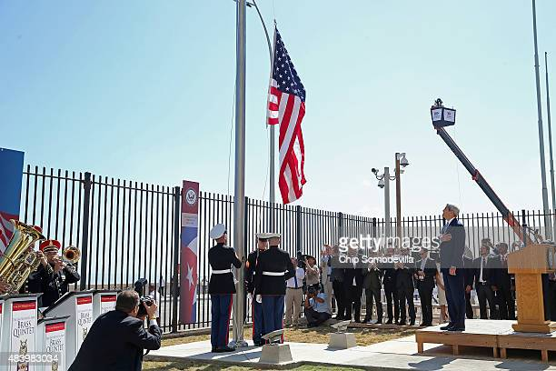 Secretary of State John Kerry watches as Marines raise the American flag at the US Embassy August 14 2015 in Havana Cuba Kerry will visited the...