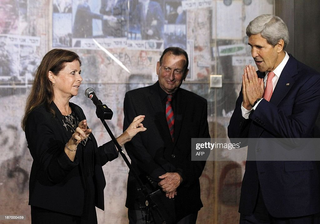U.S. Secretary of State <a gi-track='captionPersonalityLinkClicked' href=/galleries/search?phrase=John+Kerry&family=editorial&specificpeople=154885 ng-click='$event.stopPropagation()'>John Kerry</a> watches on as <a gi-track='captionPersonalityLinkClicked' href=/galleries/search?phrase=Dalia+Rabin-Pelossof&family=editorial&specificpeople=2575928 ng-click='$event.stopPropagation()'>Dalia Rabin-Pelossof</a>, daughter of assassinated Israeli Prime Minister Yitzhak Rabin, crosses her fingers as she delivers remarks on hoping for peace, as Mayor of Tel Aviv Ron Huldai looks on after a wreath laying at Rabin Square in Tel Aviv, on November 5, 2013. Yitzhak Rabin was assassinated nearby on November 4, 1995. AFP PHOTO/JASON REED/POOL