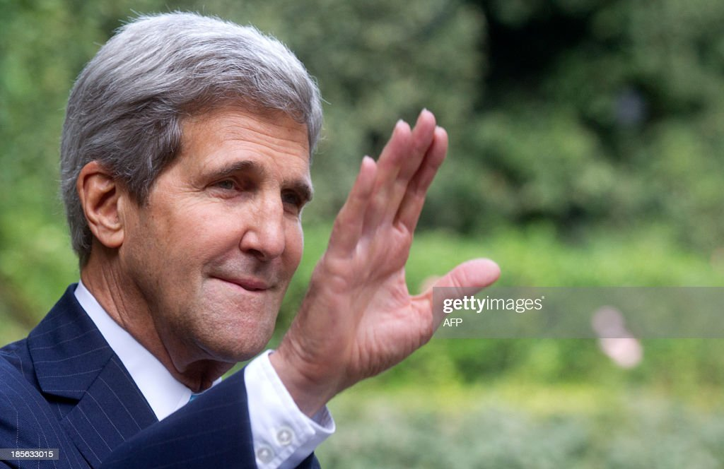 US Secretary of State John Kerry waves as he arrives for a meeting with Israeli Prime Minister Benjamin Netanyahu at Villa Taverna, the US Ambassador's residency in Rome, on October 23, 2013.