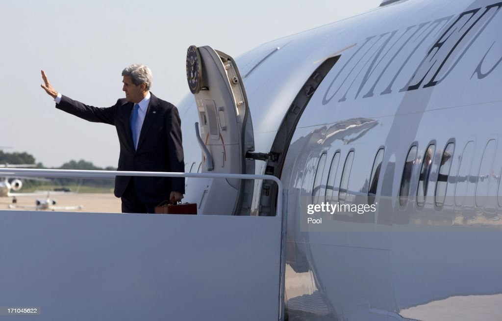 U.S. Secretary of State <a gi-track='captionPersonalityLinkClicked' href=/galleries/search?phrase=John+Kerry&family=editorial&specificpeople=154885 ng-click='$event.stopPropagation()'>John Kerry</a> waves as he boards his plane on June 21, 2013 at Andrews Air Force Base, Maryland. Kerry is en route to Doha for Syria talks.