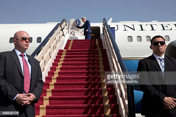 US Secretary of State John Kerry waves before boarding his plane as he leaves the Saudi capital Riyadh for Laos on January 24 2016 John Kerry...