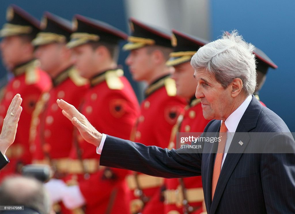 US Secretary of State John Kerry waves during a welcoming ceremony at Mother Teresa airport in Tirana on February 14, 2016. US Secretary of State is in a few hours visit to Tirana, to meet with senior government leaders to discuss Albania's further Euro-Atlantic integration and strong bilateral cooperation with the United States. / AFP / STRINGER