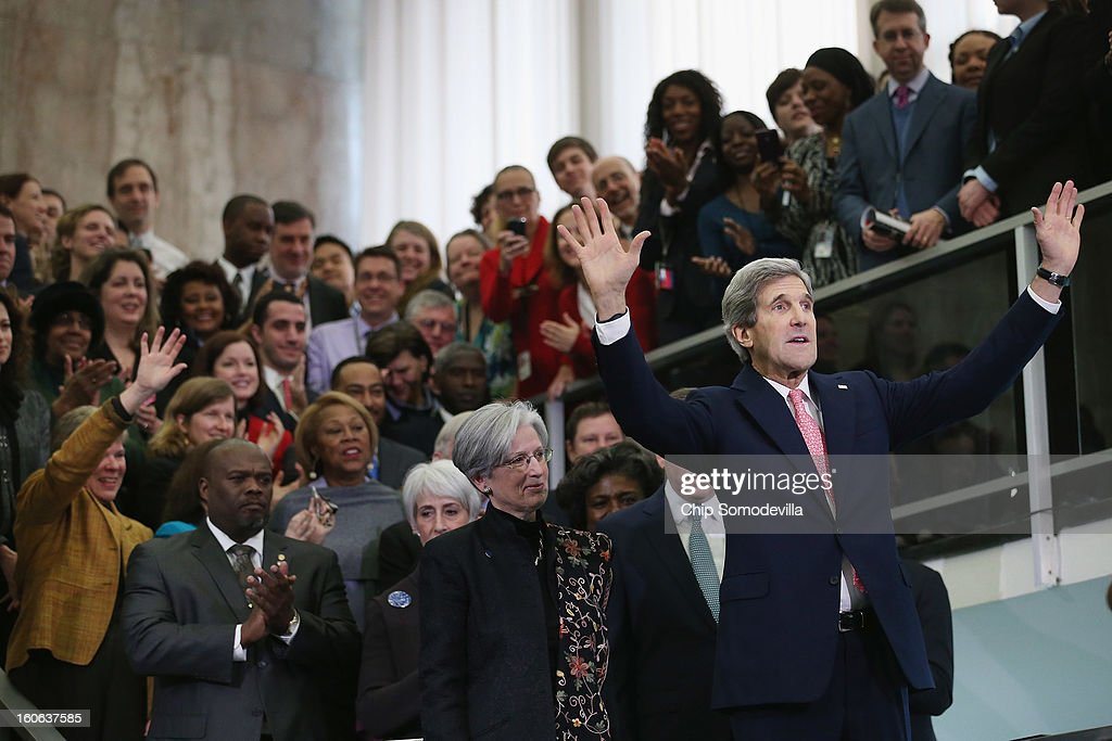 U.S. Secretary of State <a gi-track='captionPersonalityLinkClicked' href=/galleries/search?phrase=John+Kerry&family=editorial&specificpeople=154885 ng-click='$event.stopPropagation()'>John Kerry</a> waves to employees in the C Street Lobby during his first day at the State Department February 4, 2013 in Washington, DC. Kerry said he would work closely with President Barack Obama to make America safer and the world more prosperous and peaceful.