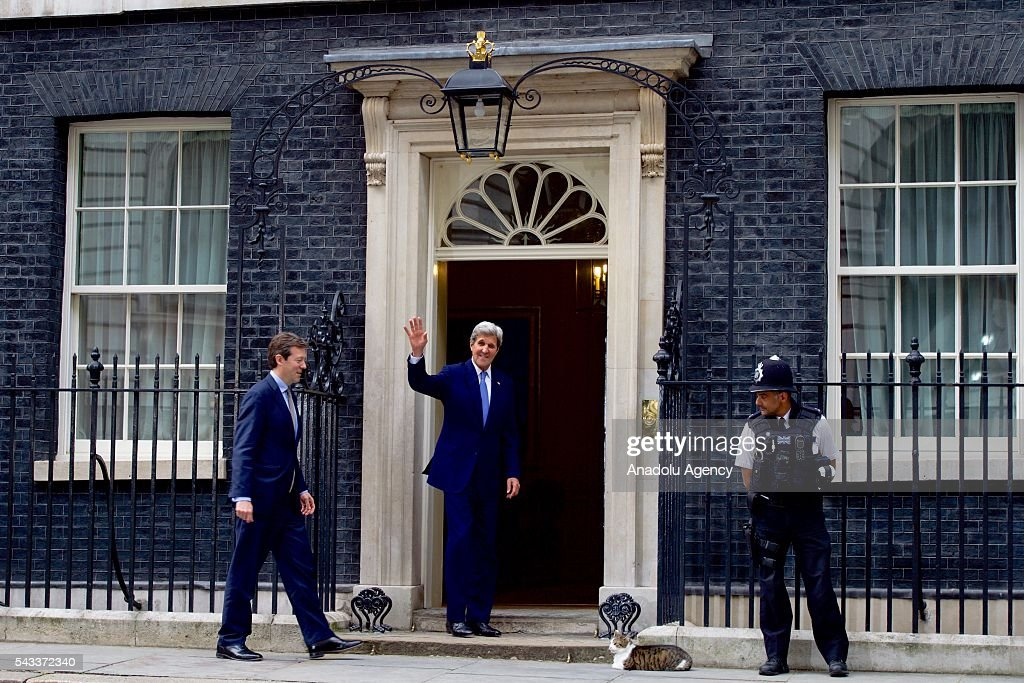 US Secretary of State John Kerry (C) waves to journalist before meeting with British Foreign Secretary Philip Hammond at the Foreign Ministry on June 27, 2016 in London, England.