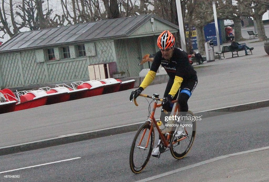 US Secretary of State <a gi-track='captionPersonalityLinkClicked' href=/galleries/search?phrase=John+Kerry&family=editorial&specificpeople=154885 ng-click='$event.stopPropagation()'>John Kerry</a> wearing an orange helmet takes a cycle tour around Lausanne, Switzerland after holding meetings with Iran's Foreign Minister Javad Zarif over Iran's nuclear program on March 20, 2015.