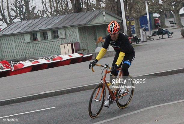 Secretary of State John Kerry wearing an orange helmet takes a cycle tour around Lausanne Switzerland after holding meetings with Iran's Foreign...