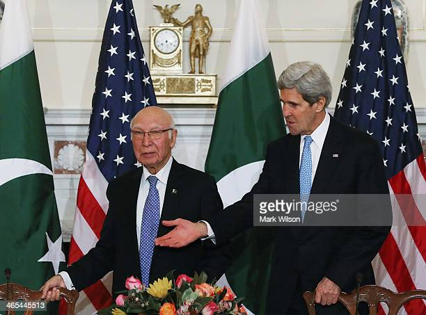 S Secretary of State John Kerry welcomes Pakistan's National Security and Foreign Affairs Advisor Sartaj Aziz before the two made remark during a...