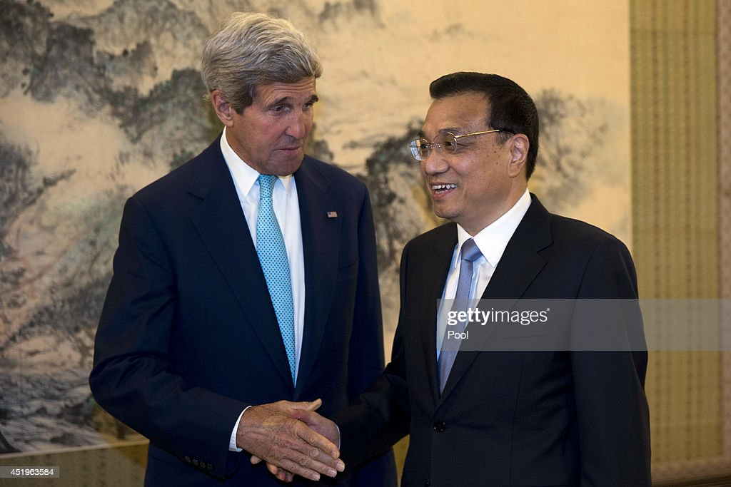 U.S. Secretary of State <a gi-track='captionPersonalityLinkClicked' href=/galleries/search?phrase=John+Kerry&family=editorial&specificpeople=154885 ng-click='$event.stopPropagation()'>John Kerry</a>shakes hands with Chinese Premier <a gi-track='captionPersonalityLinkClicked' href=/galleries/search?phrase=Li+Keqiang&family=editorial&specificpeople=2481781 ng-click='$event.stopPropagation()'>Li Keqiang</a> during a meeting at the Zhongnanhai leadership compound on July 10, 2014 in Beijing, China.