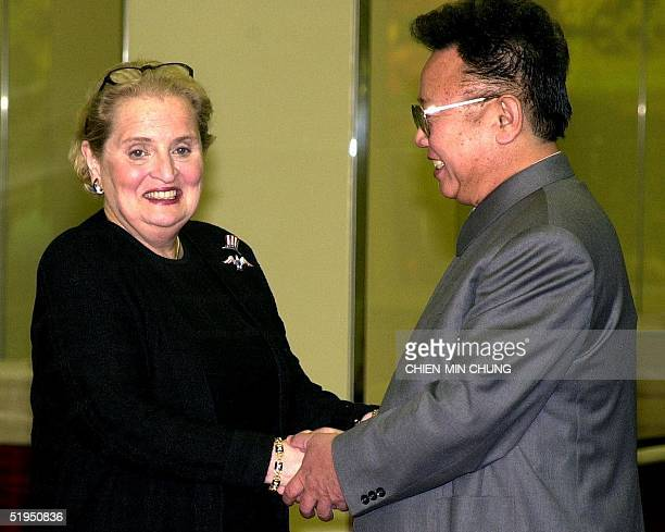 Secretary of State Madeleine Albright shakes hands with North Korean leader Kim Jong Il before a dinner in Pyongyang on 24 October 2000 The Albright...