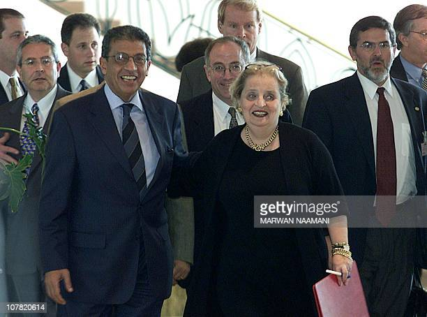 US Secretary of State Madeleine Albright shares a laugh with Egyptian Foreign Minister Amr Mussa and US Middle East envoy Dennis Ross as they walk...
