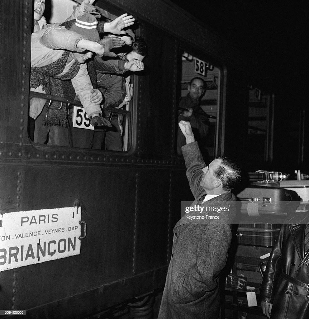 Secretary Of State <a gi-track='captionPersonalityLinkClicked' href=/galleries/search?phrase=Maurice+Herzog&family=editorial&specificpeople=1140703 ng-click='$event.stopPropagation()'>Maurice Herzog</a> At The Gare De Lyon To Meet Children Leaving For Snow Class, in Paris, France, on January 11, 1962.