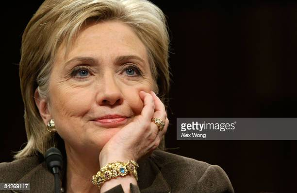 S Secretary of State Nominee and incumbent US Sen Hillary Rodham Clinton listens as she testifies during her confirmation hearing before the Senate...