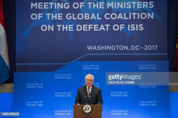 US Secretary of State Rex Tiller son speaks during the opening of a meeting of the coalition to defeat the Islamic State group at the State...