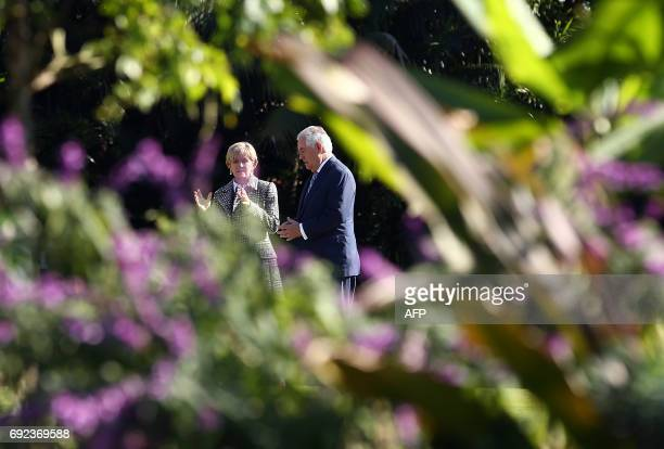 US Secretary of State Rex Tillerson and Australian Foreign Minister Julie Bishop chat as they take a garden walk at Government House for the 2017...