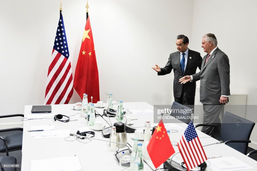 US Secretary of State Rex Tillerson (R) and China's Foreign Minister Wang Yi talk before a meeting on the sidelines of a gathering of Foreign Ministers of the G20 leading and developing economies at the World Conference Center in Bonn, western Germany, February 17, 2017. / AFP / Brendan Smialowski