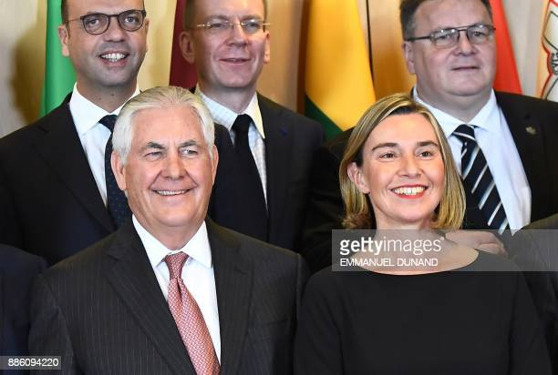 US Secretary of State Rex Tillerson and EU foreign policy chief Federica Mogherini pose for a group photo with EU foreign ministers at the European...
