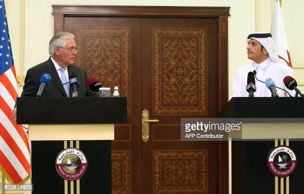 US Secretary of State Rex Tillerson and Qatari Foreign Minister Sheikh Mohammed bin Abdulrahman AlThani speak during a press conference in Doha on...