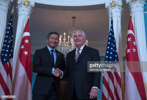 US Secretary of State Rex Tillerson and Singapore's Foreign Minister Vivian Balakrishnan shake hands at the State Department in Washington DC on...