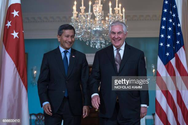 US Secretary of State Rex Tillerson and Singapore's Foreign Minister Vivian Balakrishnan arrive for a photo opportunity at the State Department in...