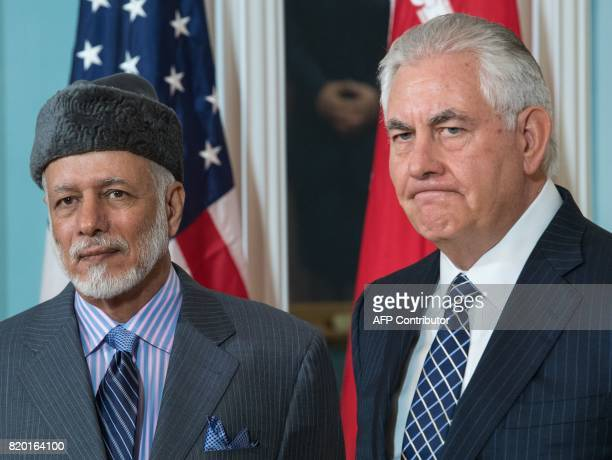 US Secretary of State Rex Tillerson answers a question from the media standing with the Foreign Minister of Oman Yusuf bin Alawibin Abdullah inside...