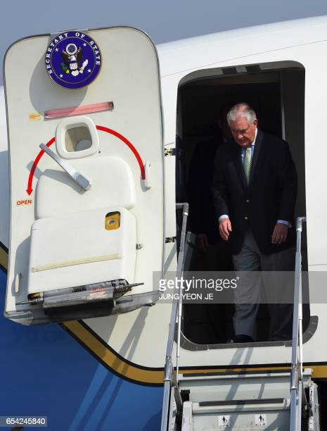 US Secretary of State Rex Tillerson arrives at US Osan Air Base in Pyeongtaeck on March 17 2017 Tillerson began a tour of the region where tensions...