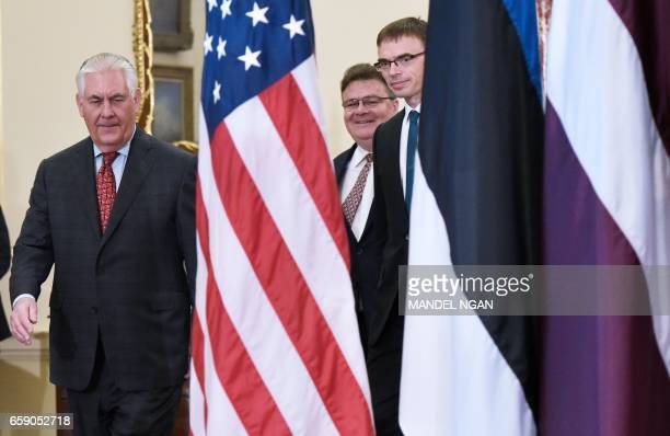 US Secretary of State Rex Tillerson arrives to pose for a photo with Lithuanian Foreign Minister Linas Linkevicius and Estonian Foreign Minister Sven...