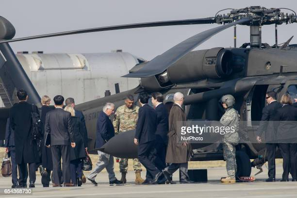 US Secretary of State Rex Tillerson center with white hair walks toward a helicopter upon his arrival at Osan Air Base in Pyeongtaek South Korea US...