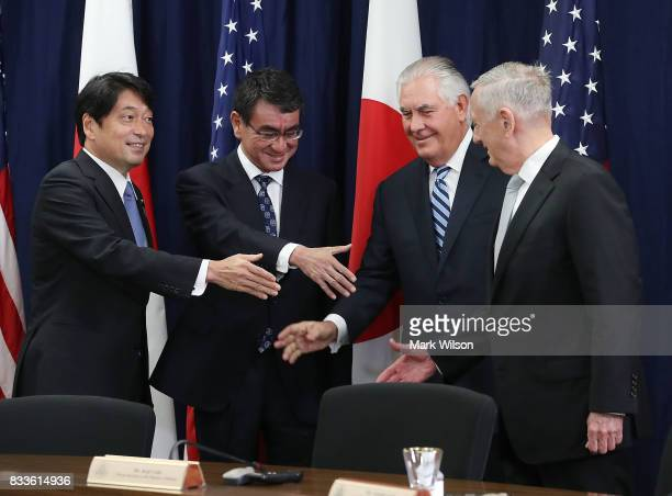 Secretary of State Rex Tillerson Defense Secretary James Mattis shake hands with Japanese Foreign Minister Taro Kono and Defense Minister Itsunori...