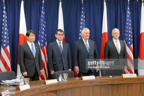 Secretary of State Rex Tillerson Defense Secretary Jim Mattis shake hands with Japanese Foreign Minister Taro Kono and Defense Minister Itsunori...