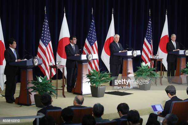 Secretary of State Rex Tillerson Defense Secretary Jim Mattis stand with Japanese Foreign Minister Taro Kono and Defense Minister Itsunori Onodera...