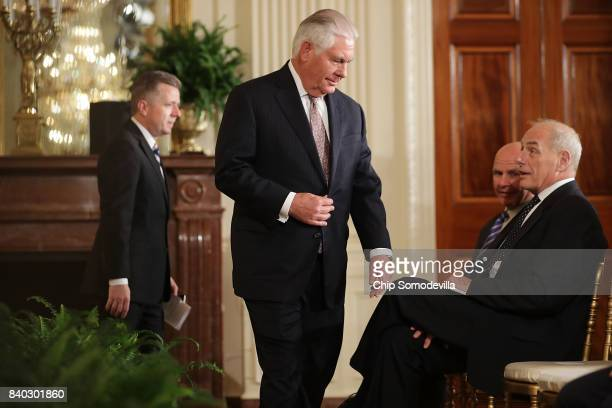 Secretary of State Rex Tillerson finds a seat next to National Security Advisor HR McMaster and White House Chief of Staff John Kelly before a joint...