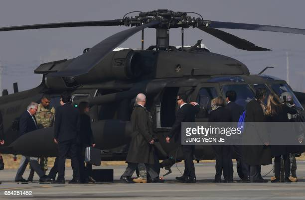 US Secretary of State Rex Tillerson gets in a UH60 Blackhawk after he arrived at US Osan Air Base in Pyeongtaeck on March 17 2017 Tillerson began a...