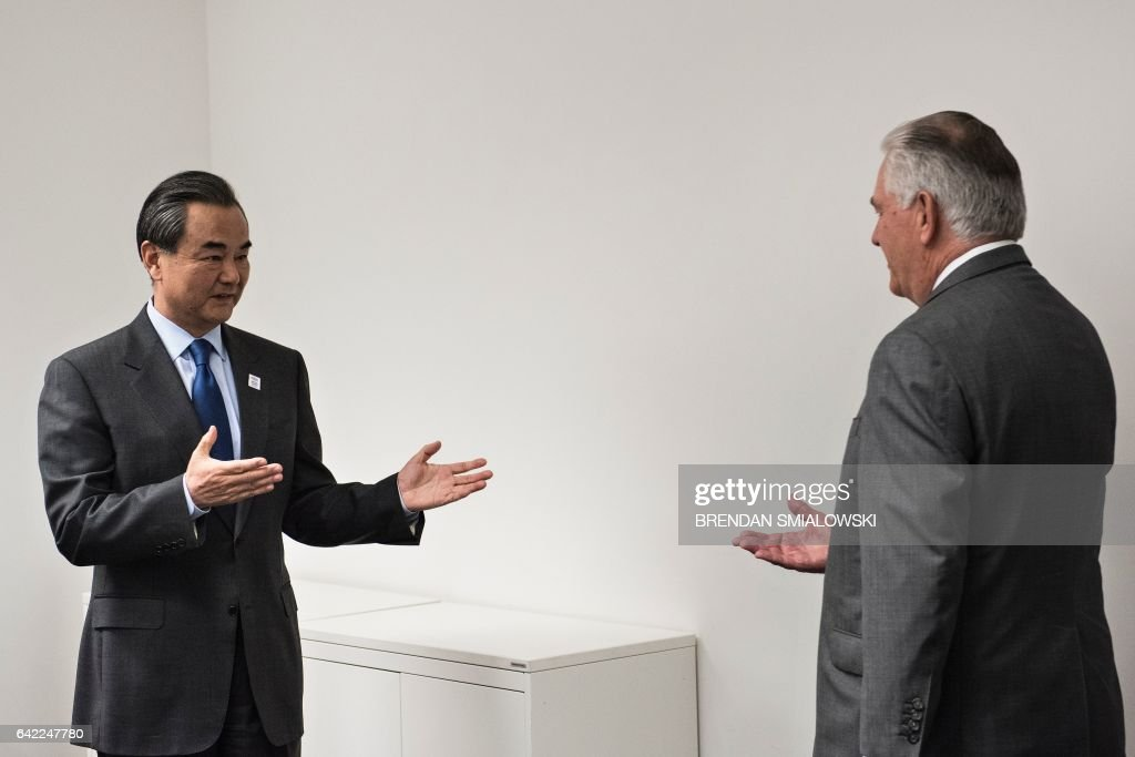 US Secretary of State Rex Tillerson (R) is greeted by China's Foreign Minister Wang Yi before a meeting on the sidelines of a gathering of Foreign Ministers of the G20 leading and developing economies at the World Conference Center in Bonn, western Germany, February 17, 2017. / AFP / Brendan Smialowski