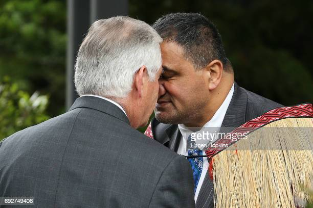 Secretary of State Rex Tillerson is greeted with a hongi by Parliamentary kaumatua Kura Moeahu and Defence Minister Gerry Brownlee prior to a meeting...