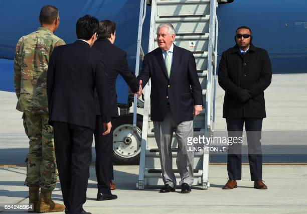 US Secretary of State Rex Tillerson is welcomed after he arrived at US Osan Air Base in Pyeongtaeck on March 17 2017 Tillerson began a tour of the...