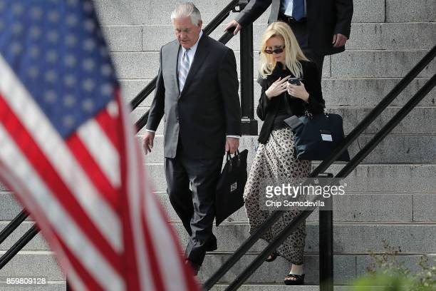 S Secretary of State Rex Tillerson leaves the Eisenhower Executive Office Building before heading to the White House West Wing to meet with President...