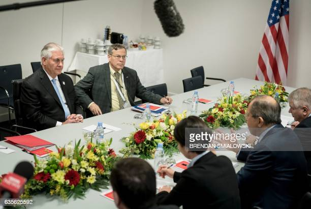 US Secretary of State Rex Tillerson listens to Russian Foreign Minister Sergei Lavrov at the start of a meeting at the World Conference Center...