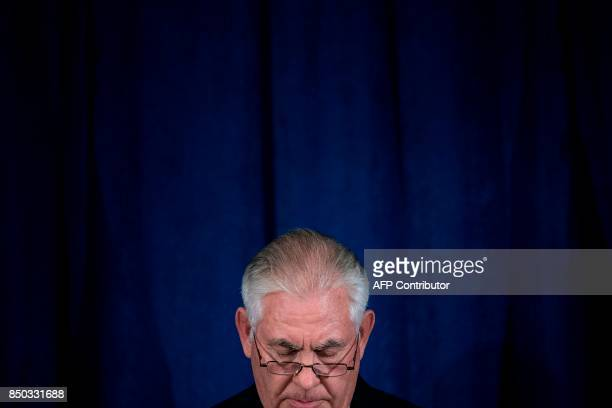 US Secretary of State Rex Tillerson pauses while speaking to the press at the Hilton Midtown about an earlier P51 meeting on the Iran Nuclear deal at...
