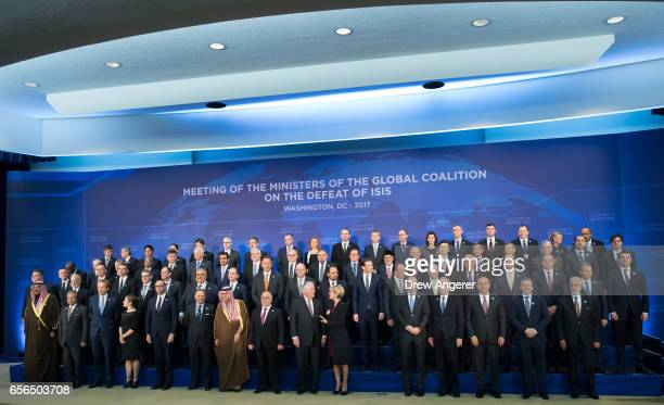 S Secretary of State Rex Tillerson poses for a photo with leaders from the 'Global Coalition Working to Defeat ISIS' at the State Department March 22...