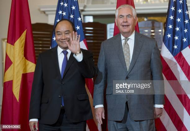 US Secretary of State Rex Tillerson shakes and Vietnamese Prime Minister Nguyen Xuan Phuc prior to a working lunch at the State Department in...